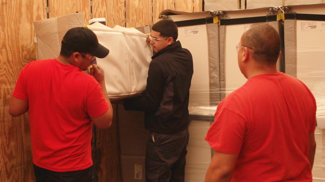 Guys-unloading-truck